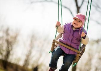Pure joy - swinging child