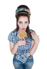 Young beautiful woman in retro pin-up style with lollipop