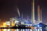 power station at night with smoke
