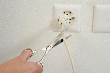Scissors cutting the current