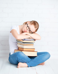 ired student girl asleep hugging books