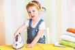 cute  baby girl housewife iron clothes iron, is engaged in domes