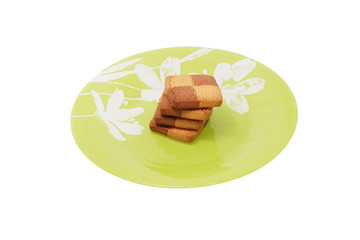 Cookies in the green plate. Isolated.