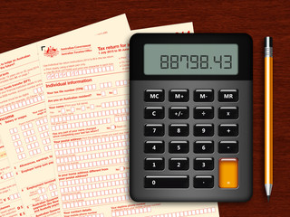 australian tax return with calculator and pencil on wooden table