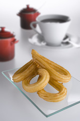 Spanish typical fried churros with a cup of hot chocolate