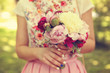 Hands of a woman holding beautiful peonies bouquet - 81297156