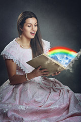 Beautiful woman and rainbow magical book