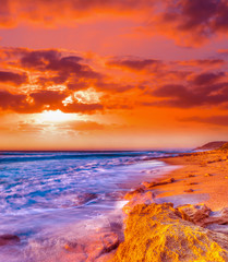 rocky coastline at sunset in Castelsardo