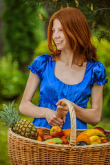 red-haired smiling young woman with a fruit basket