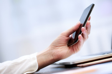 Close up of a woman using smartphone