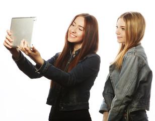 young women taking a self portrait
