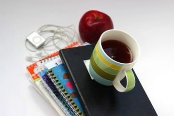 Notebooks, Apple, Cup, glasses and player