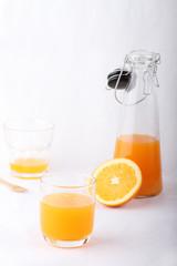 glass of orange juice and a bottle of orange juice