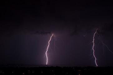 Lightning over a city at night .