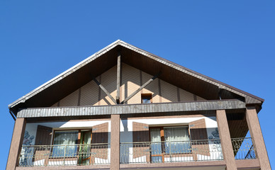 Pediment of the guest house against the blue sky