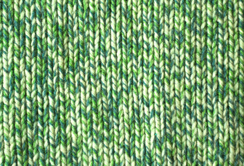 Major binding of green wool as background closeup