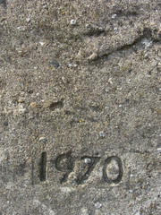 date 1970 embedded in gray stone with pebbles