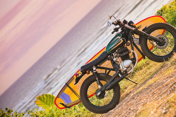 Motorcycle with surfboard at outdoors