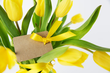 Bouquet of yellow tulips with card