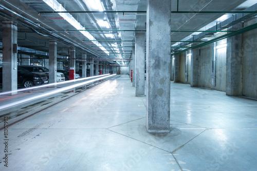 Car lights in the big underground city parking. - 81307983