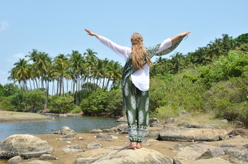 Young woman meditating on Agonda beach. Goa, India