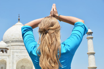 Young woman meditating atTaj Mahal. Agra, India