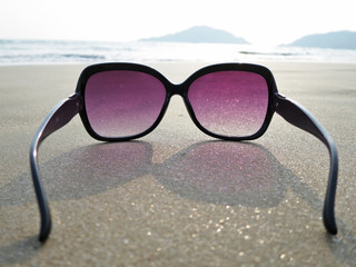 Sunglasses on the sand of Palolem beach. South Goa, India