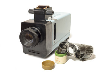 Old slide projector with film.
