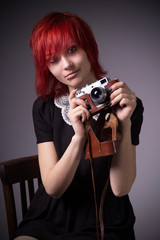 Young girl with vintage camera