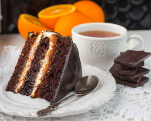 Delicious chocolate cake with cream and fruit