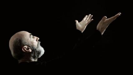Religious man raising hands to Grace