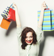 woman with colored shopping bags