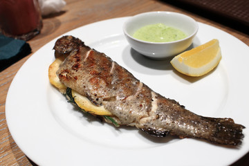 Grilled trout on a plate