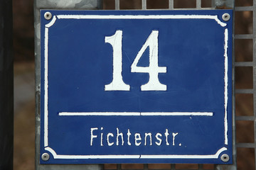 Traditional blue street sign in Munich, Germany.