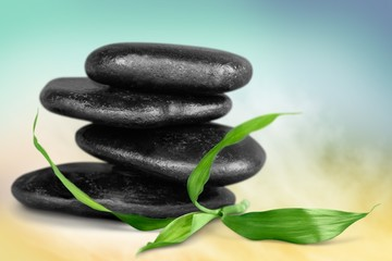 Spa Treatment. Massage Stones with Mint Leaves