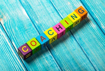 Crossword. Concept of coaching word on wooden colorful cubes