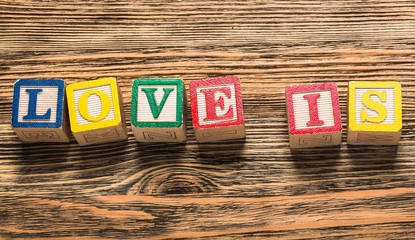 Love. Love forever text on a vintage cubes on a wooden