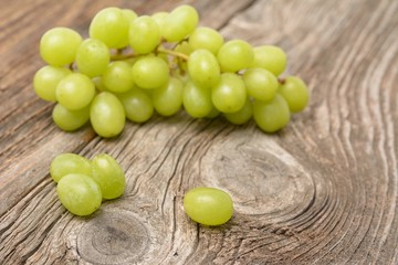 green grapes on wooden background