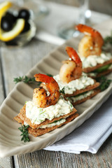 Appetizer canape with shrimp and cucumber