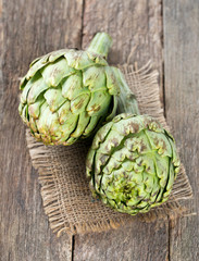 artichokes on old wooden surface