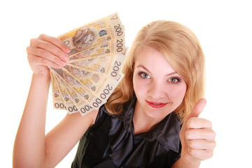 Business woman holds polish money giving thumb up