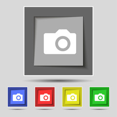 Digital photo camera icon sign on the original five colored butt