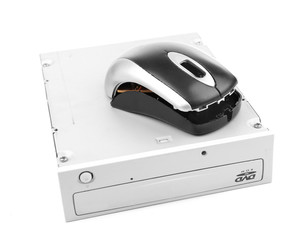 Old video recorder and broken computer mouse isolated on white