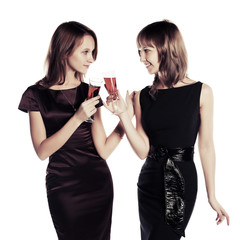 Two young beautiful fashion women with a wine glass