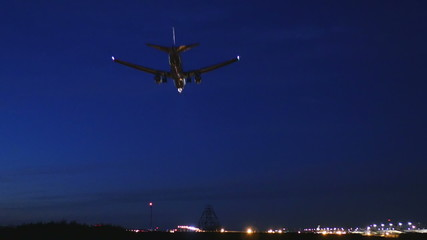 Closeup of landing airplanes at Narita Airport