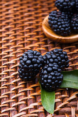 Blackberry on wicker background
