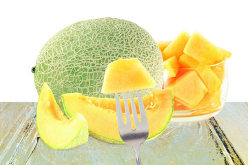 cantaloupe melon cut and whole in pure white background