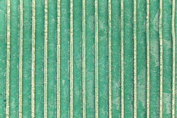 Green rubber surface.