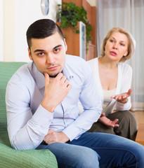 Woman explaining something to man