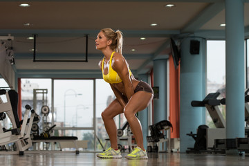Athletic Woman Workout With Kettle Bell